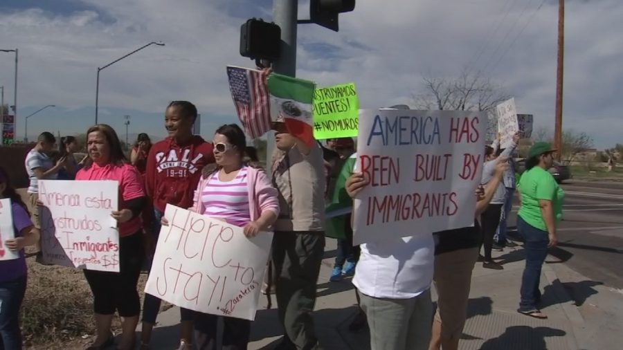 A+group+of+Immigrants+and+friends+hold+signs+to+help+%22Day+Without+Immigrants%22+in+Arizona.