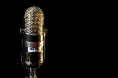 Microphone on the left side of black background