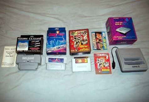 Early gaming console and game cards on a white cloth