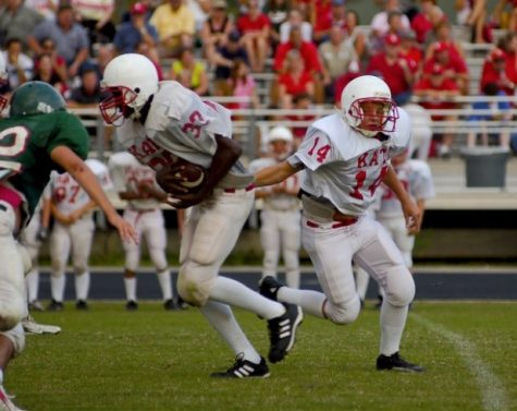 Football player running a play
