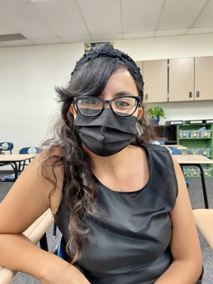 Mrs. Rivera, an English teacher at La Joya Community High School sits down facing the camera with a mask on for an interview about the rising coronavirus cases in school.