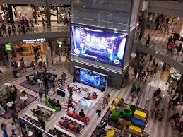 a mall of games and people inside