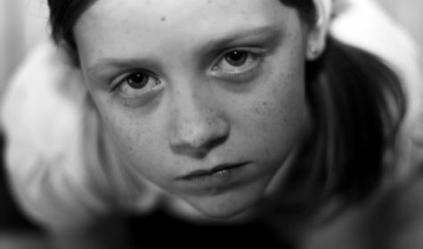 Black & white photo of a girl being sad.