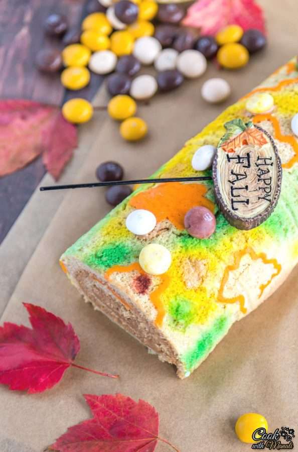 A fall dessert with a small wooden sign laying on top saying happy fall