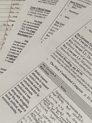 A close up of several packets of homework.